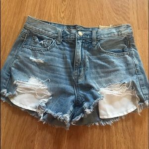 AMERICAN EAGLE BLUE JEAN DISTRESSED SHORTS